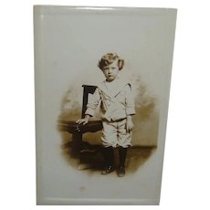 Early Real Photo Tinted Postcard Little Boy in High Top Boots, Sailor Shirt, Knickers and Curly Hair