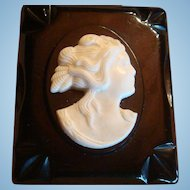 High Relief White Cameo on 3 Dimensional Bakelite Frame Brooch