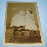 Real Photo Postcard Baby With Large French Fashion Doll Victorian Chair