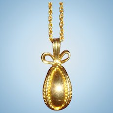 Joan Rivers Classic Golden Egg Wrapped in Ribbon with a Bow Necklace