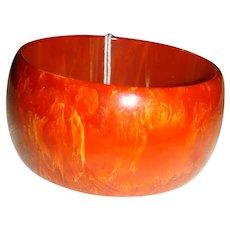 """Deep Carnelian Orange Swirl Bakelite 1 1/2"""" Wide Domed Bracelet"""