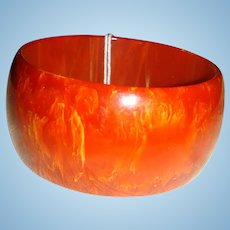 "Deep Carnelian Orange Swirl Bakelite 1 1/2"" Wide Domed Bracelet"