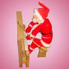 Vintage Christmas Ornament Santa Playing Piano
