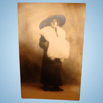 Real Photo Postcard Millinery and Furs Hat, Collar, Muff Larger Than Pretty Lady
