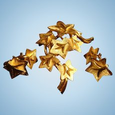 Crown Trifari Shiny and Satin Gold Tone Climbing Star Flowers Vine Brooch and Earrings
