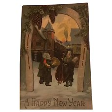 1909 New Year's Embossed Postcard Village Musicians, Horseshoe, Pine Cones, Snowy Winter Scene