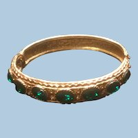 Textured Gold Tone Hinged Bracelet with 7 Oval Emerald Green Rhinestones