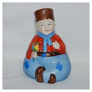 Figural porcelain inkwell – Dutch boy with flowers