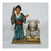 Cold painted metal inkwell with Oriental lady