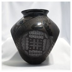 "Four sided black on black Mata Ortiz pot – Eduardo ""Chevo"" Ortiz."