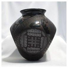 "Four sided black on black Mata Ortiz pot – Eduardo ""Chevo"" Ortiz."