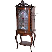 Regina Corona Automatic Changer 15-1/2″ Disc Music Box with Stained Glass Front