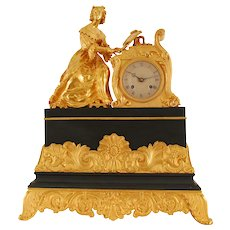 French Figural Mantel Clock of Woman Playing a Piano