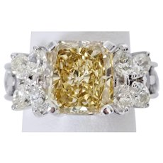 Exquisite 4.27 Carat Radiant Cut Fancy Yellow Diamond Ring in 18K White Gold