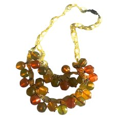 Bakelite Necklace Carved Beads on Celluloid Chain