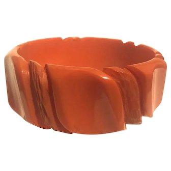 Bakelite  Bangle Bracelet Deeply Carved in Orange