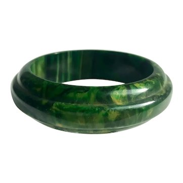 Bakelite Bangle Bracelet Carved Saturn Shape in Heavily Marbled Green