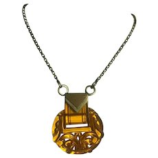 """Bakelite Carved Pendant on a 24"""" Brass Chain"""