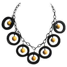 Bakelite Necklace Carved Rings with Yellow Balls