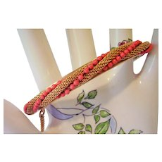 Bangle Bracelet -  Faux Coral Bead and Gold tone Mesh in Twist Design - Vintage Bracelet - Unsigned