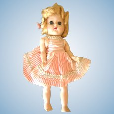Cosmopolitan Hard Plastic Girl Doll