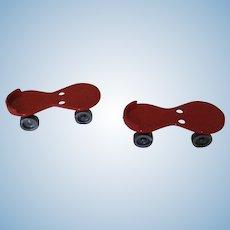 Red Plastic Roller Skates