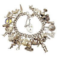 Vintage 1979 Silver Charm Bracelet 28 SHAKESPEARE Related Charms 90.2g.