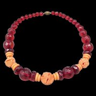 Faceted Cherry Amber Bakelite Bead and Coral Celluloid Necklace