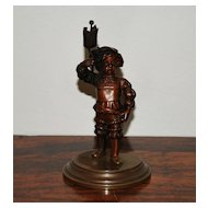 Miniature Dutch Bronze of a Boy in Uniform, c. 1910
