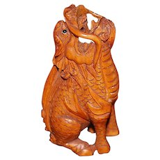 Finely Carved Boxwood Barking Dragon Netsuke