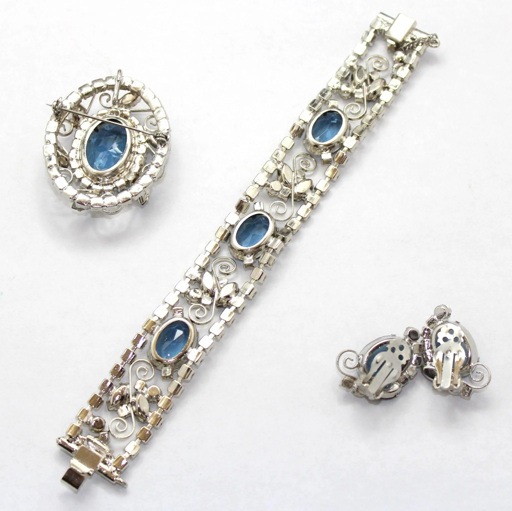 plated set pin and swarovski with brooch clear pinwheel rhodium sapphire sherman
