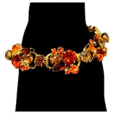 Vintage Juliana Fall colored Topaz, and (orange) Sun Rhinestone Bracelet
