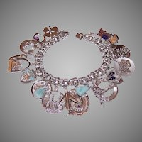 Retro Sterling Silver Charm Bracelet with 21 Shiny Charms