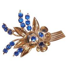 Czechoslovakia Gold Tone Blue Rhinestone Floral Costume Pin Flower Brooch