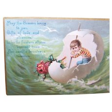 Victorian Embossed Greeting Card for Easter or Christmas - Boy in Eggshell Boat with Roses