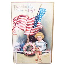 """International Art Publishing Co """"Lest We Forget"""" Patriotic Red White Blue Postcard - Postally Used"""