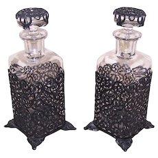 Pair Art Deco Glass Eau de Cologne Bottles in Black Wire Filigree Holders