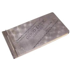 C.1900 Advertising Aluminum Note Holder - Compliments of GOOD LUCK Clothiers!