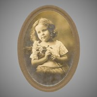VINTAGE Photograph - Little Girl Holding Long Stemmed Roses