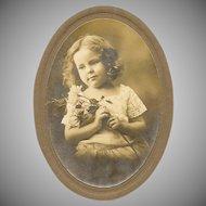 VINTAGE Photograph - Little Girl Holding Long Stemmed Roses