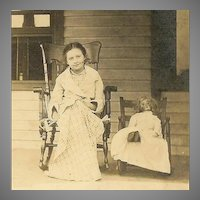 VINTAGE Photograph - Young Girl, Rocking Chair, With Her Doll