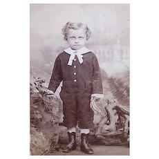 VICTORIAN Cabinet Card Photo - Little Boy with Curls, Shabbily Dressed, Holding String