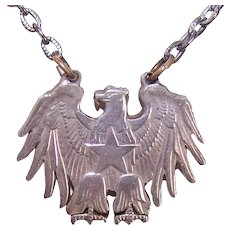 Cut Out American Eagle Dollar Coin Pendant