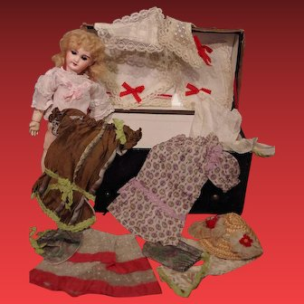 ** Small French Doll with Trousseau **
