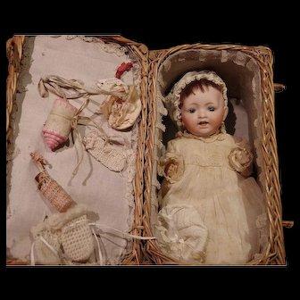 ** Antique Bisque Baby In Wicker basket ***
