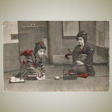 Japanese Geishas at Tea Ceremony. Tinted Postcard