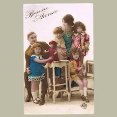 Happy New Year Postcard Family with Toys 1929