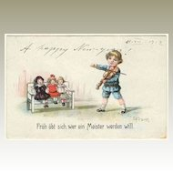Vintage Postcard Boy performing Music for Dolls. 1919