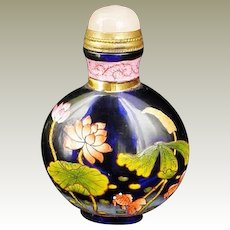 Chinese Snuff Bottle of enameled Glass and Lotus Motif