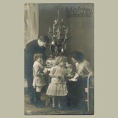 Christmas Postcard with Kids and Doll 1913